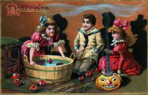 A halloween scene with children bobbing for apples is printed on this Tuck postcard from early 20th century published in London, England. (Photo by Transcendental Graphics/Getty Images)